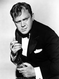 Thomas Mitchell Posed in Black Suit Photo by  Movie Star News