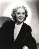 Alice Faye sitting on the Couch wearing Black Robe Photo by  Movie Star News