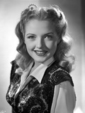 Virginia Patton smiling in Embroidered Dress Top Photo by  Movie Star News