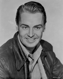 Alan Ladd smiling and wearing a Black Jacket Photo by  Movie Star News