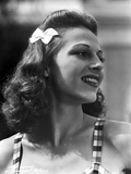 Vera Zorina looking away from the camera, wearing stripped two-inch straps, and a white bow in her  Photo by  Movie Star News