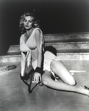 Anita Ekberg sitting on the Floor While Chained to it in Classic Portrait Photo by  Movie Star News