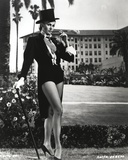 Anita Ekberg standing with a Cane wearing a Black Suit in Classic Portrait Photo by  Movie Star News
