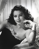 Ava Gardner posed on Couch in Black Dress with Necklace Photo by  Movie Star News