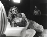Anita Ekberg Lying on a Couch wearing a Dress in Classic Portrait Photo by  Movie Star News