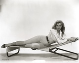 Anita Ekberg sitting on the Floor, Holding a Furniture in Classic Portrait Photo by  Movie Star News