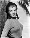 Corinne Calvet Leaning on Tree, wearing Sweater Photo by  Movie Star News