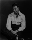 Errol Flynn sitting on the Floor wearing White Long Sleeve Photo by  Movie Star News