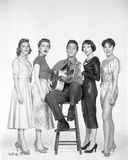 A portrait of Elvis Presley and backup singers. Photo by  Movie Star News