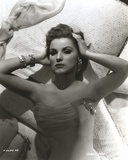 Debra Paget Lying on Bed in Black and White Photo by  Movie Star News
