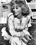 Connie Stevens sitting in White Dress with Pistol Photo by  Movie Star News