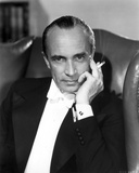 Conrad Veidt sitting in Black Coat with Cigarette in His Hand Photo by  Movie Star News