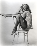 Anita Ekberg sitting in a Chair, One Leg Raised Classic Portrait Photo by  Movie Star News