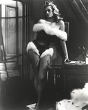 Anita Ekberg Holding on the Table wearing a Furry One Piece in Classic Portrait Photo by  Movie Star News