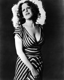 Bette Midler Posed Chin Up with Hand on the Skirt in Striped Deep V-Neck Dress Photo by  Movie Star News