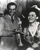 Billie Holiday smiling in Formal Suit Along with Woman Photo by  Movie Star News