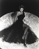 Ava Gardner posed in Long Black Gown with Stockings and Stiletto Photo by  Movie Star News