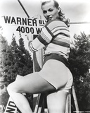 Anita Ekberg Looking Back on the Ladder Fixing a Sign in Classic Portrait Photo by  Movie Star News