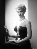 Jan Sterling Portrait in White Neck Strap Black Shoulder Dress with Left Hand on the Lap Photo by  Movie Star News