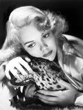 Jane Wyman Portrait in Shiny Silk Dress with Head Leaning on a Tiger Figurine Photo by  Movie Star News