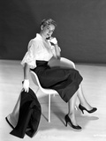 Vera Miles casually posed sitting in a white chair, wearing white chiffon top Photo by  Movie Star News
