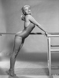 Jayne Mansfield Posed Facing to the Left and Bent Over in Grey One Piece Swimsuit Photo by Bert Six