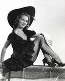 Janet Leigh Reclining on the Table in Black Sleeveless V-Neck Silk Dress Photo by  Movie Star News