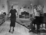 Al Jolson Playing a Piano While the Girl is Dancing in a Classic Movie Scene Photo by  Movie Star News