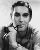 Tyrone  Powers smiling in Close Up Portrait wearing Yellow Winter Coat Photo af Movie Star News