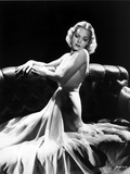Jane Wyman Posed and Seated on the couch in White Silk Halter Dress with Hands on the Top Railing Photo by  Movie Star News