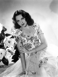 Linda Darnell sitting wearing Floral Dress in Black and White Photo by  Movie Star News