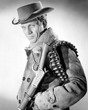 Steve McQueen Posed in Black and White Portrait wearing Cowboy Outfit with Rifle Foto von  Movie Star News