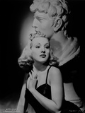 Betty Grable Portrait with Hands on the Chest near the Neck in Black Strap Velvet Dress Photo by  Movie Star News