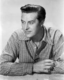 Ray Milland Looking Away wearing Checkered Long Sleeves in Black and White Portrait Photo by  Movie Star News