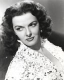 Jane Russell Portrait in White Floral Lace Dress while Leaning Back and Looking to the Right Photo by  Movie Star News