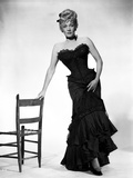 Marlene Dietrich standing in Strapless Black Dress with Chair Photo by  Movie Star News