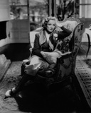 Marlene Dietrich sitting on Couch, wearing Black Dress with Head Leaning on Hand Photo by  Movie Star News