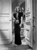 Marlene Dietrich standing in Black Dress with One Hand Holding to the Door Photo by  Don