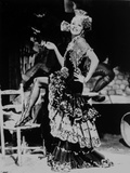Marlene Dietrich standing One Leg in Floral Gown with One Leg Stepping on Chair Photo by  Movie Star News