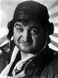 John Belushi wearing a Motorcycle Hat and a Black Jacket in a Close Up Portrait Photo by  Movie Star News