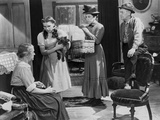 Wizard Of Oz Three People Listening at Old Woman Talking in Black and White Photo by  Movie Star News