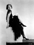 Clara Bow sitting on Stair, wearing Black Dress with One Leg Raise Photo by ER Richee