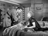 Behave Yourself Man in Grey Suit Talking to the Woman Petting a Terrier in Black Dress Photo by  Movie Star News
