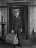Al Jolson Leaving with a Big Bag wearing a Black Suit and a Hat Classic Movie Scene Photo by  Movie Star News