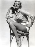 Anita Ekberg sitting on a Chair wearing a Glossy Long Sleeves in a Classic Portrait Photo by  Movie Star News