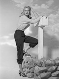 Jayne Mansfield Posed in White Tucked-On Long Sleeve Shirt while Leaning on the Mailbox Photo by Bert Six