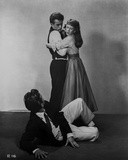 James Dean East of Eden standing in Black Vest and White Long Sleeve while Hugged by a Woman Photo by  Movie Star News