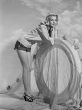 Jayne Mansfield Posed and Bent Over in White Long Sleeve Shirt and Black Short Skirt Photo by Bert Six