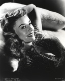 Paulette Goddard smiling while Lying on Couch in Glitter Dress Portrait Photo by  Movie Star News