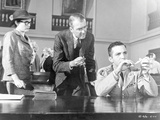 Anatomy Of A Murder Woman Watching the Two Men Testing an Evidence in a Movie Scene Photo by  Movie Star News